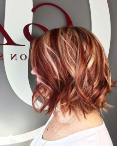 pops of blonde in red hair