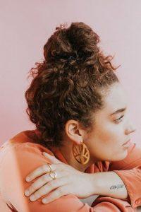 high bun undone curls